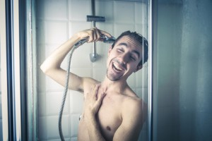 Happy man in the shower